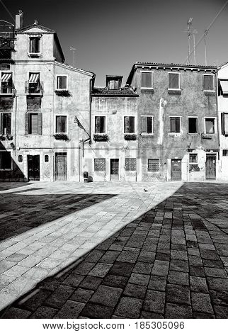 Traditional Venetian houses and yard in black and white Venice Italy
