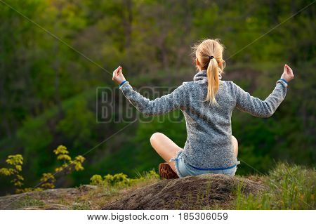 Traveler young Woman relaxing meditation with view green mountains landscape. Back view. Travel Lifestyle hiking concept summer vacations outdoor