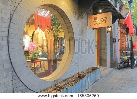 BEIJING CHINA - OCTOBER 27, 2016:  Souvenir shop in Nanluoguxiang lane. Nanluoguxiang lane has become a popular tourist destination with restaurants and bars.