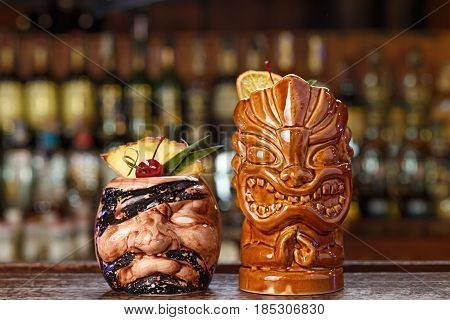 Refreshing alcoholic summer cocktails stand in a bar on a blurred background of alcohol. Menu image