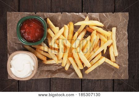 French fries with ketchup and mayonnaise, shot from above