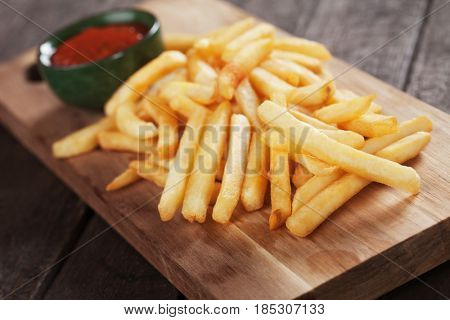French fries, fried potato sticks served with ketchup