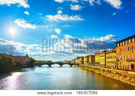 Florence or Firenze Ponte Santa Trinita medieval Bridge landmark on Arno river sunset landscape. Tuscany Italy.