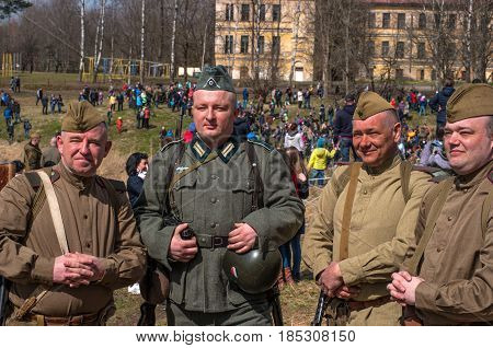 Gatchina Russia - May 7 2017: Historical reconstruction of the battles of World War II. German and Soviet soldiers after the battle - photographing for memory.