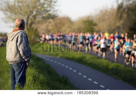FREDERICIA DENMARK - MAY 6 2017:Spectator looking at Little Belt Half Marathon Race between Middelfart and Fredericia over the New Little Belt Bridge in Denmark. May 6 2017.