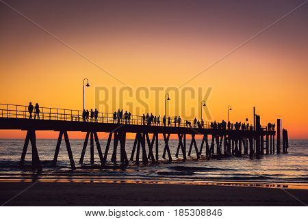 Glenelg beach jetty with people at sunset Adelaide South Australia