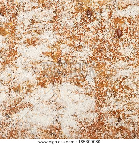 Close-up fragment of the floured bread crust as a backdrop texture composition
