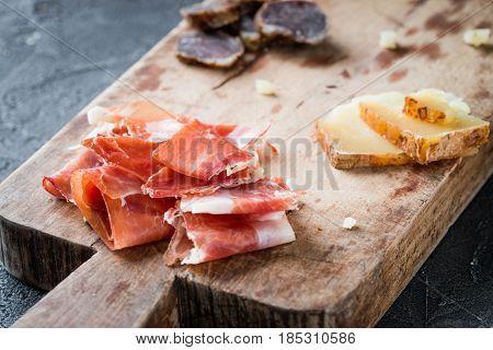 Platter With Spanish Ham Jamon Serrano Or Italian Prosciutto Crudo, Homemade Dried Meat Salami, Slic