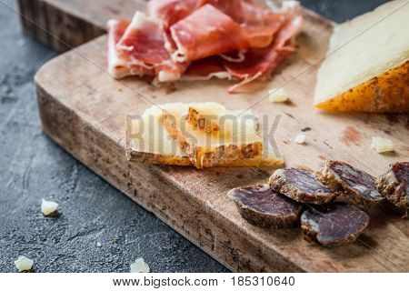 Platter With Homemade Dried Meat Salami, Sliced Italian Hard Cheese Pecorino Toscano, Spanish Ham Ja