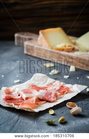 Ham Jamon Serrano Or Prosciutto Crudo With Sliced Hard Cheeses (italian Pecorino Toscano And Spanish