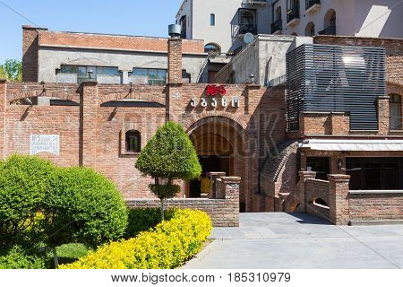 Tbilisi, Georgia - April 24, 2017: Abanotubani, Sulfur Bath 5 in old town of Tbilisi and part of the green park