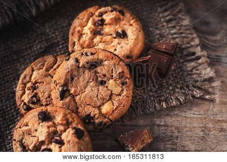 Chocolate chip cookies on dark old wooden table with place for text. freshly baked. Selective Focus with Copy space.