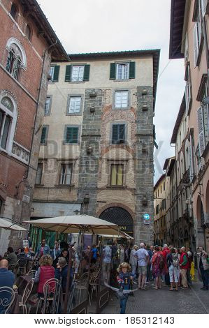 Italy Lucca - September 18 2016: the view of open air cafe and people on Lucca's street September 18 2016 in Lucca Tuscany Italy.