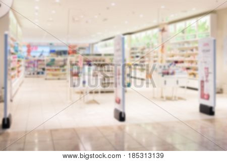 Blur abstract defocused drugstore with medicine on shelves background.
