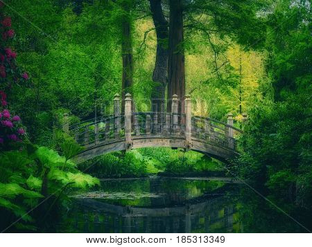 Japanese style bridge over a pond in spring