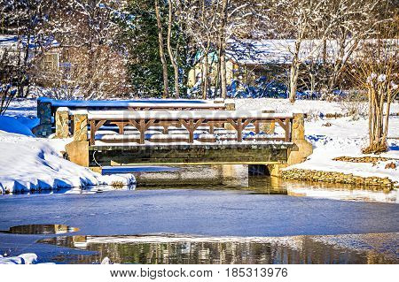 car crossing bridge and surrounding winter wonderland
