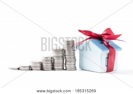 House Piggy Bank With Coins Stacked Isolated