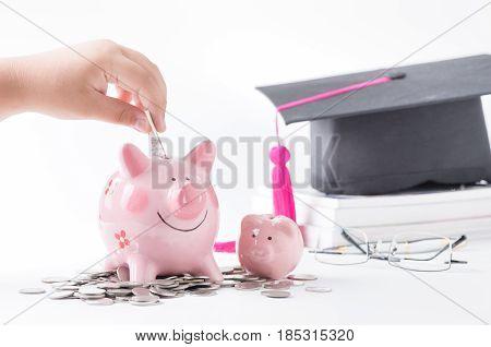 Child Hand Put Notebank In A Piggybank,