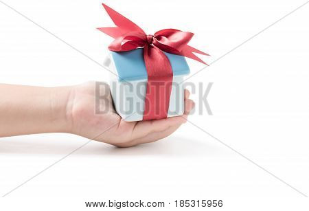 House Piggy Bank With Red Ribbon In Little Hand