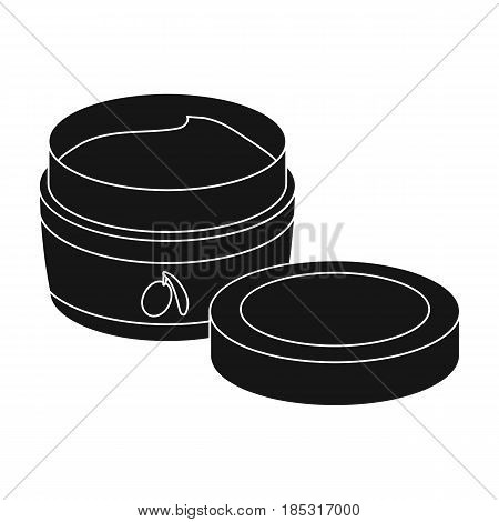 A can of olive cream.Olives single icon in black style vector symbol stock illustration .