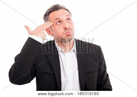 Portrait Of Young Man Pretending To Shoot Himself