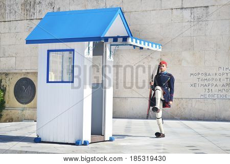 ATHENS GREECE, JANUARY 12 2016: greek evzones, greek tsolias, guarding the presidential mansion in front of the tomb of the unknown soldier, army infantry. Editorial use.