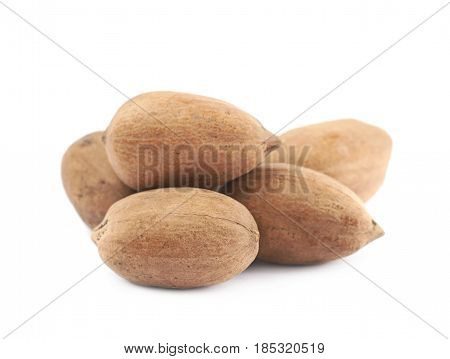 Pile of pecan nuts isolated over the white background