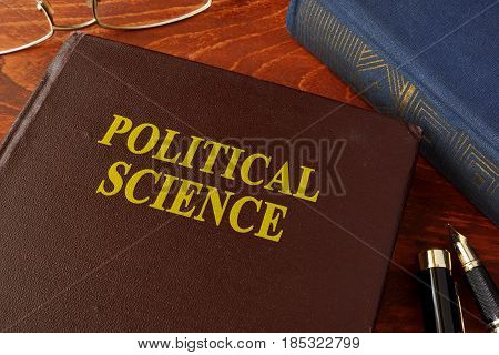 Book with title political science in an office.