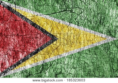 Grudge stone painted Guyana flag close up