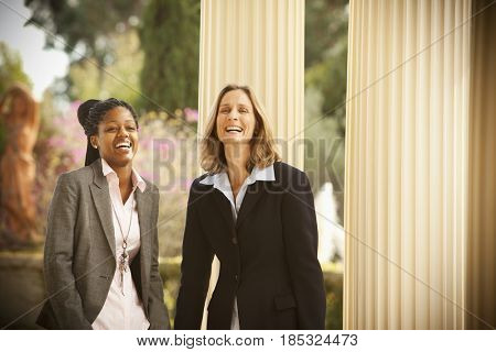 Businesswomen laughing together outdoors