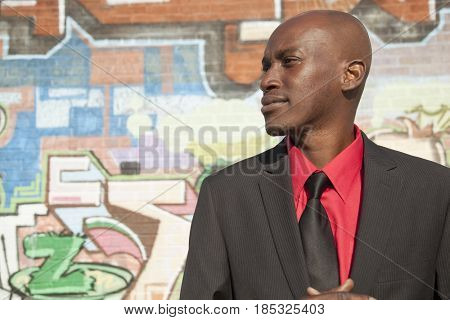 Serious African American businessman in urban area