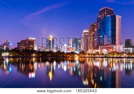 City Downtown Skyline At Night With Water Reflection, Bangkok,thailand