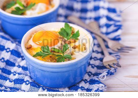 Eggs En Cocotte Baked With Spinach, Parsley And Cream.