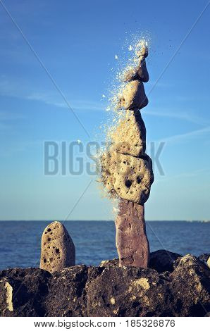 Totem of zen stones on beach shattered