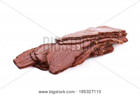 Pile of ham meat slices isolated over the white background