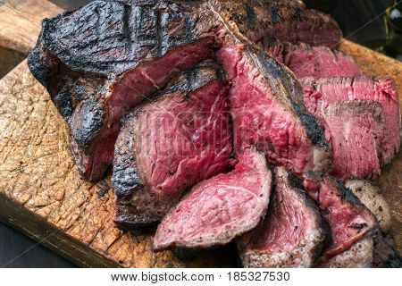 Barbecue dry aged Wagyu Porterhouse Steak as close-up on an cutting board