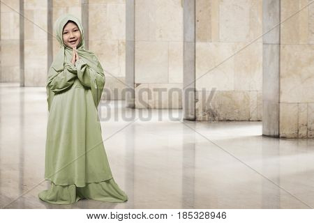 Asian Muslim Kid In Green Hijab Clothes Praying