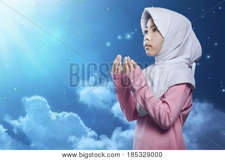 Little Asian Muslim Kid In Hijab Pray