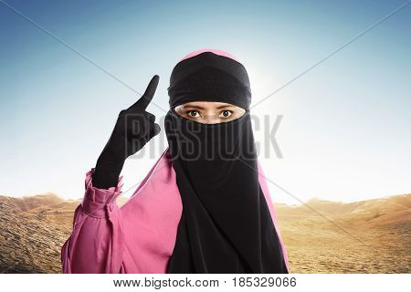 Portrait Of Asian Muslim Woman With Veil Standing In Rage Emotion