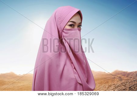 Young Asian Muslim Woman With Hijab Standing