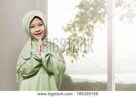 Asian Muslim Girl Wearing Hijab Praying