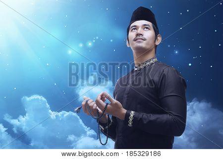 Handsome Asian Muslim Man Praying With Prayer Beads