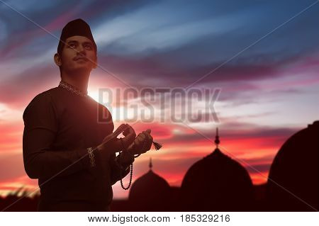 Religious Asian Muslim Man With Prayer Beads Praying To God