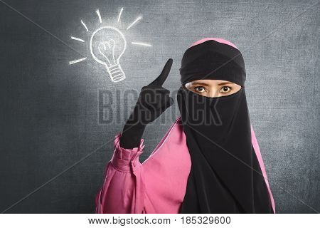 Young Asian Muslim Woman Wearing Hijab Having New Idea