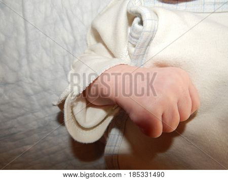 The hand of a child and an adult