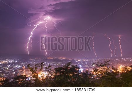 Lightning with dramatic clouds.Night thunder-storm over city