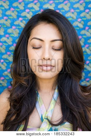 Indian woman with eyes closed
