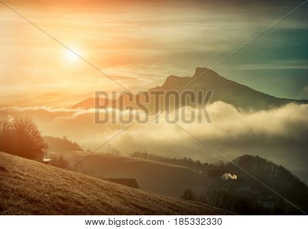 Beautiful Mountains view at morning. Sunrise in austrian mountains at morning time. Sunlight and cloudy sky.