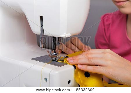 The sewing process on an electric sewing machine