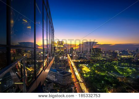 Evening period cityscape at Lumpini park Bangkok skyline Thailand